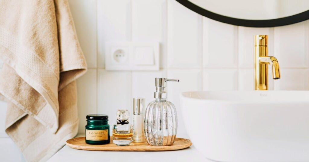 small bathroom counter with tray of beauty products