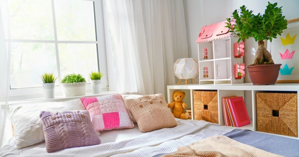 Small kids bedroom ideas with cubby shelves and bins adjacent to the bed for toys and storage