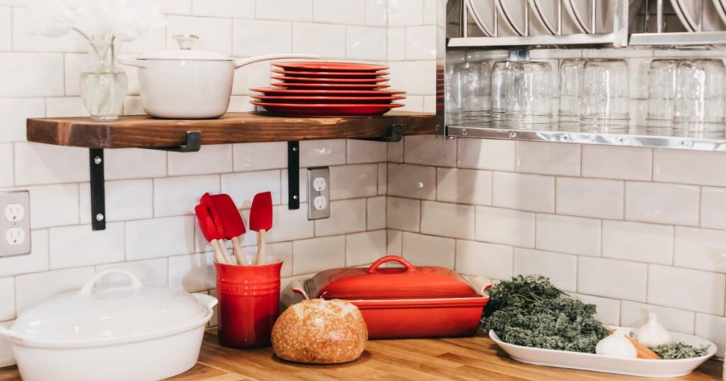 kitchen space savers shelves and hooks in a cute small kitchen
