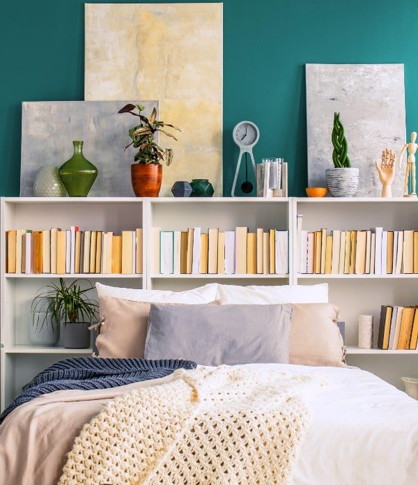 When there's no room for nightstands in your small bedroom, try using bookcases behind the bed as a nightstand alternative.